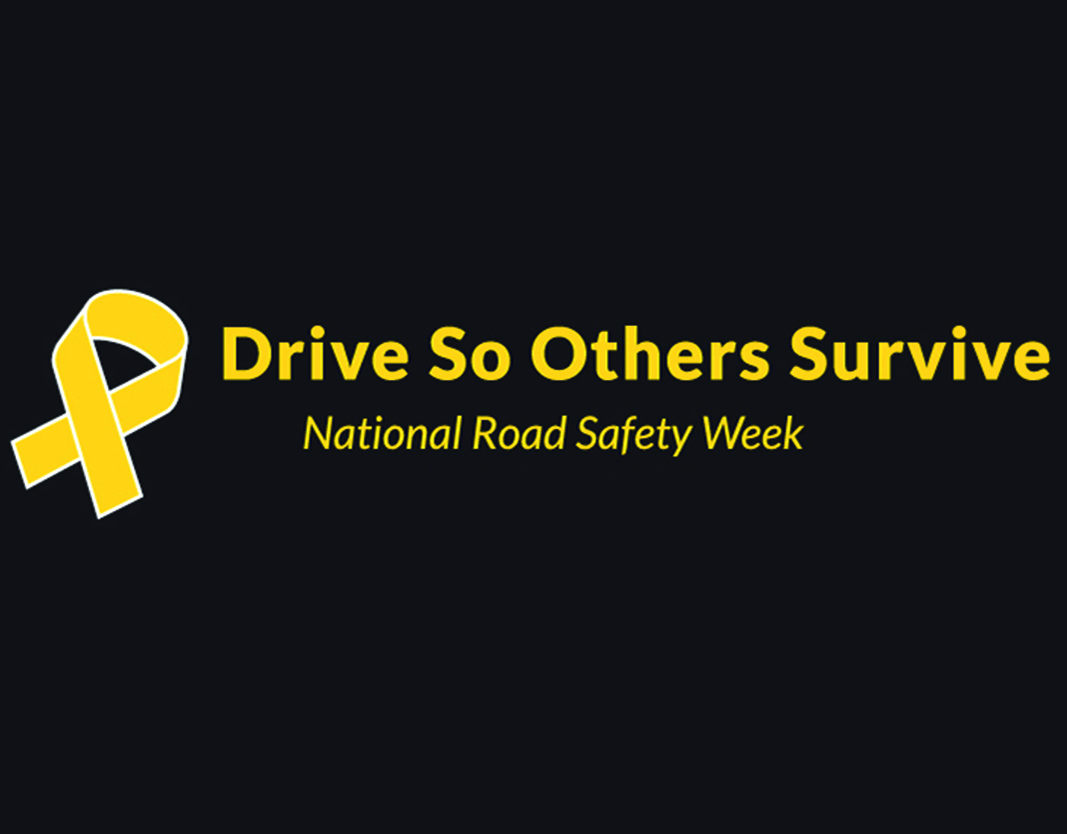 A black background with a yellow ribbon and yellow text. The text reads Drive so others survive. National Road Safety Week.