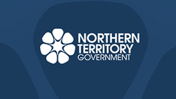 Blue back background with the Northern Territory dessert rose logo in white and Northern Territory Government in white text on the right side of it.