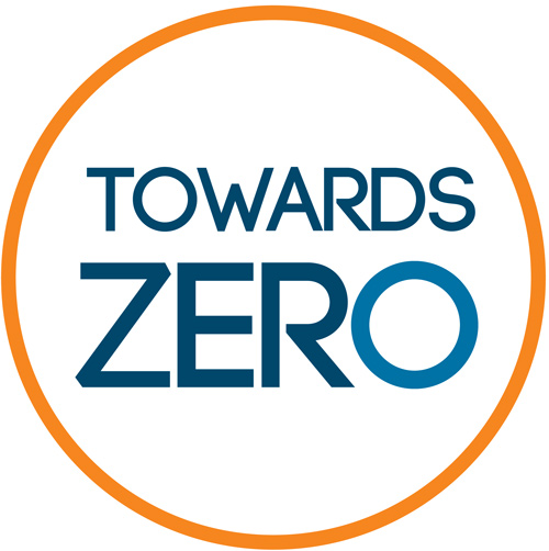A circle outlines in orange with a white filling holds the text, Towards Zero.