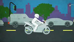 A cartoon motorcycle riding on the ride. Two cars are in the lane next to it.